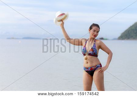 Bikini with women body sexy symbol hat and sunglasses on Thung Wua Lan Beach at Chumphon Province Thailand
