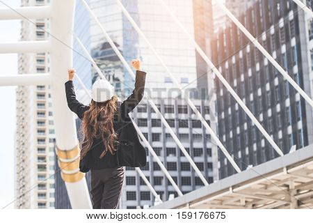 Middle-aged Engineer Or Architect Woman In Winner And Success In Business. Middle-aged Women Profess
