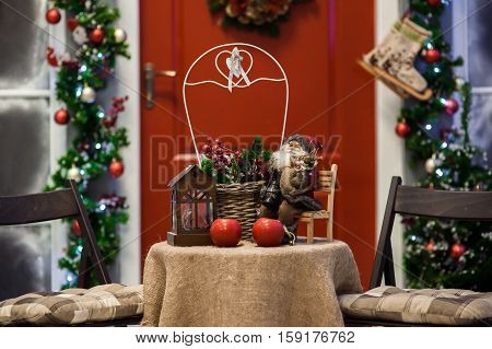 Red Door Porch With Christmas Wreath And Holiday Decorations