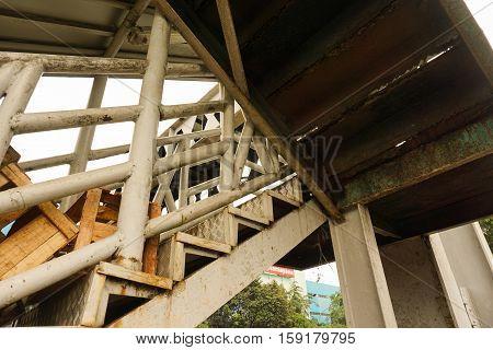 rusty pedestrian bridge in indonesia java jakarta