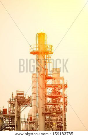 Oil refinery plant at sunrise with sky background, Thailand