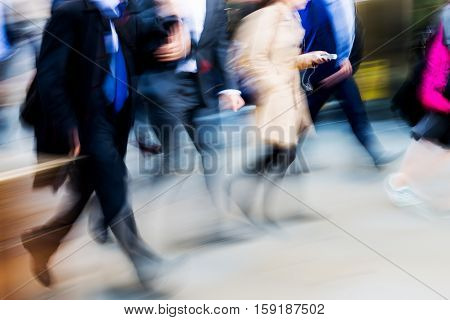 Crowd Of Walking People In Motion Blur