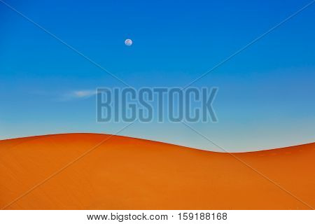 Sand Dunes And Almost Full Moon