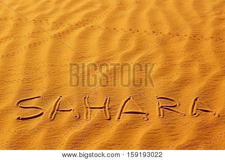 Word Sahara Written On The Sand