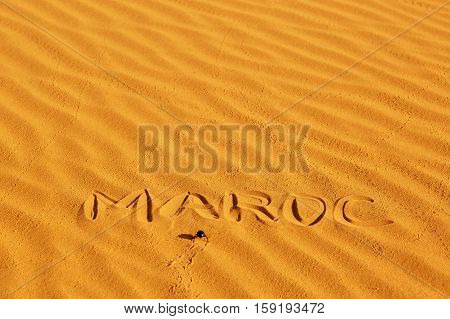 French Word Maroc Written On The Sand