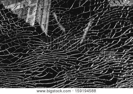 Abstract background of cracked and broken glass. black and white color background