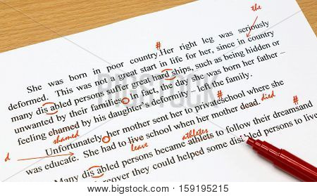 english proofreading sheet with red marks on table