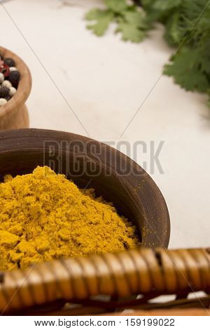 Turmeric powder in pottery and other spices