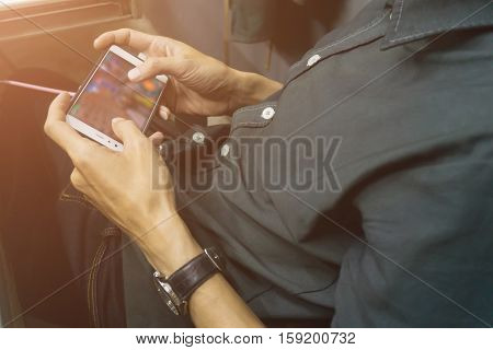 Asian Business Men Holding And Using Smart Phone Screen