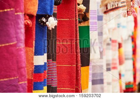 Colorful Fabrics And Carpets For Sale In Morocco