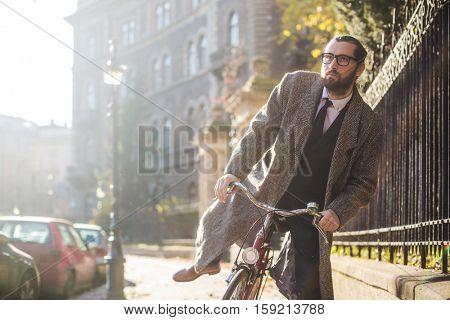 Guy on a bike outside
