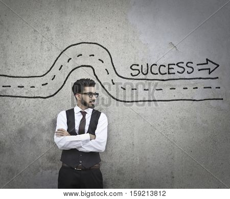Guy thinking about the way to success