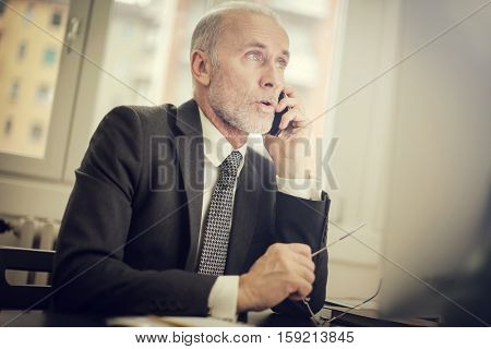 Guy talking on the phone in work