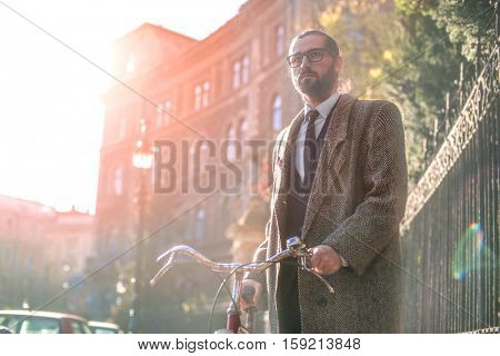 Guy in the city with a bike