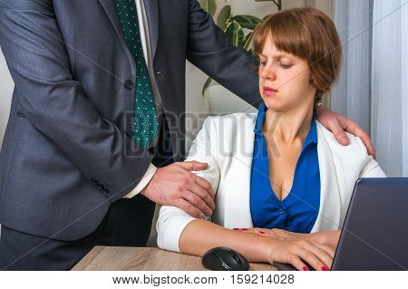 Man Touching Woman's Shoulder - Sexual Harassment In Office
