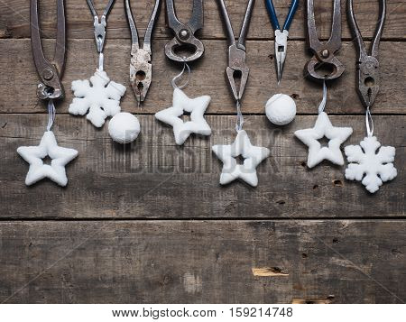 Christmas background with old used tools on a rustic wooden table