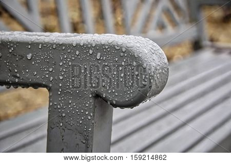 Condensation on a park bench during a cloudy day