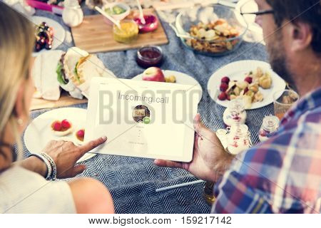 People Picnic Relaxation DIgital Tablet Communication Technology Concept