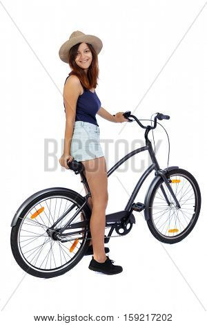 back side view of a woman with a bicycle. cyclist sits on the bike. Rear view people collection.  backside view of person. Isolated  over white background. A smiling girl is sitting on a bicycle.