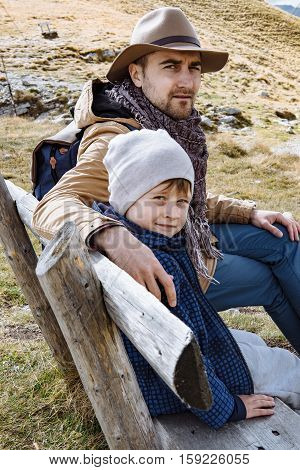 Father And Son Travel Together In Autumn Mountains Durmitor, Montenegro