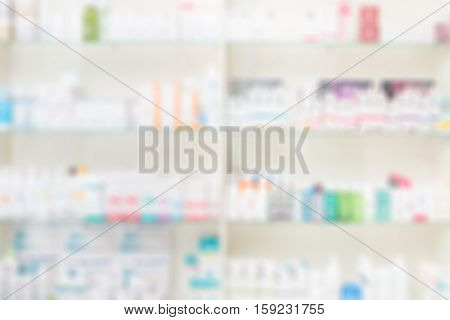 store pharmacy shelf drug medical shop drugstore background medication blank medicine table pharmaceutics healthcare care concept blur blurred business space copyspace - stock image