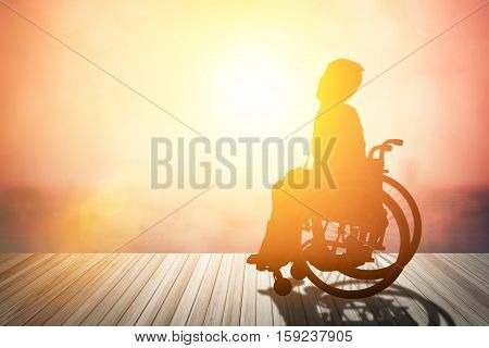 silhouette of disabled on wheelchair or background.day of the disabled person .Concept cripple or disabled .art Plant Dawn View Cloud Calm Card Bright Blue World model love night sunrise alone