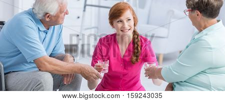 Nurse Giving Pills To Patients