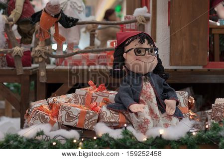BRNO,CZECH REPUBLIC-NOVEMBER 19,2016:Christmas elf sitting on gifts at shopping center Olympia on November 19, 2016 Brno Czech Republic