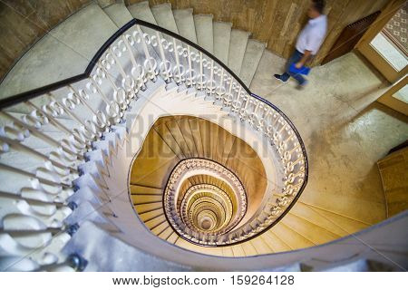Color image of a spiral staircase in a building.