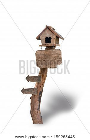 Wooden bird house on wooden sign isolated on white background. File contains a clipping path.