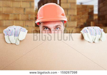 Happy Constructor Standing Behind Cardboard