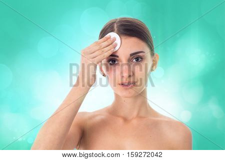 cute Young girl takes care her skin with Cleansing cotton pad isolated on white background. Health care concept. Body care concept. Young woman with healthy skin.