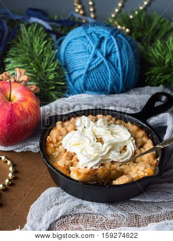 Apple Crumble With Cream As Christmas Dessert. Vertical