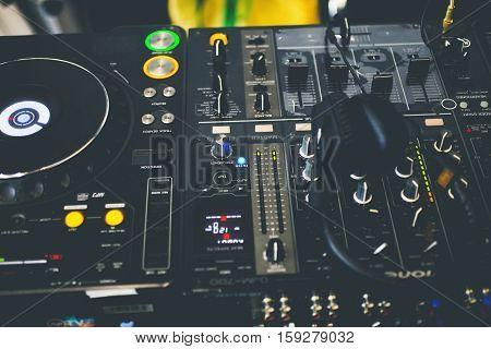 DJ CD player and mixer with DJ headphones.
