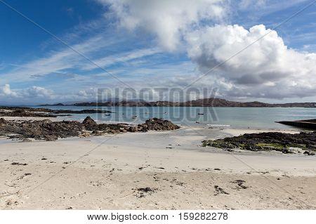 White sand beach Scottish island of Iona Scotland uk Inner Hebrides view to the Isle of Mull