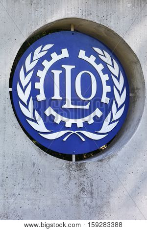 Geneva, Switzerland - August 14, 2016: ILO sign on a wall. ILO is a United Nations specialized agency which promotes international human and labour rights