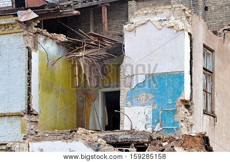 Process of demolition of a residential building. Ruined walls and hardwood floors. Theme of war refugees destruction and reconstruction.