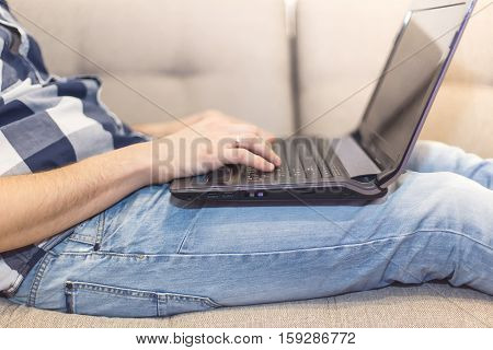 the man on the couch with a laptop