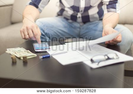 a man at a table counting money