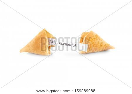 Fortune cookie with message LIFE IS BEAUTIFUL isolated on white