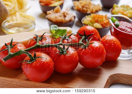 Tomatoes with pasta on background