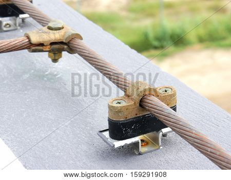 Cable Saddle of Lightning Protection System on the roof edge