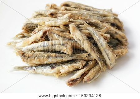 Anchovies in breadcrumbs and fried in oil. Cooked and ready. Italian culinary specialties.