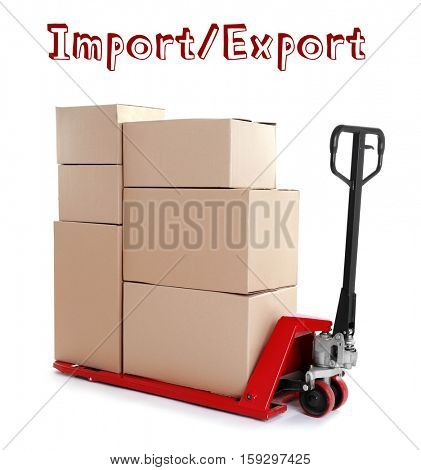 Text IMPORT/ EXPORT and palette truck with cardboard boxes on white background. Wholesale and logistics concept.