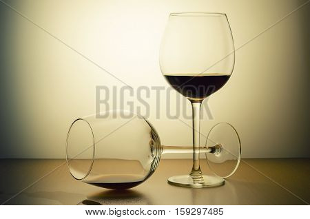 two glasses of alcohol taken on a warm background