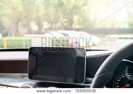Black GPS device screen for navigation to destination of driver Tablet screen computer for navigator in car