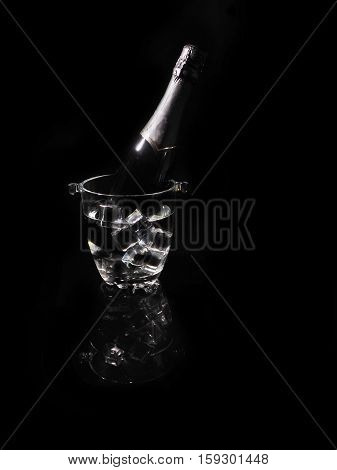 Bottle Of Champagne In An Ice Bucket With Glass