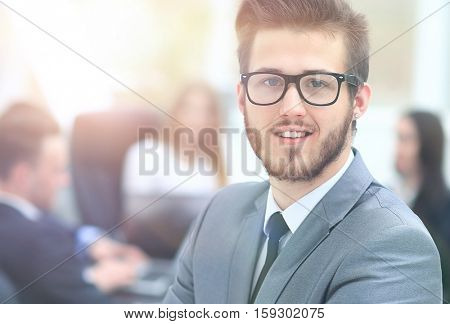 Portrait of an handsome businessman in front of his team