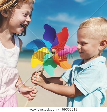 Kids Child Beach Sibling SIster Brother Blowing Concept