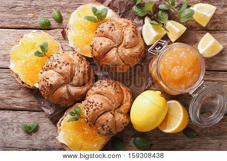 Sweet Sandwiches With Lemon Jam And Butter Close-up. Horizontal Top View, Rustic